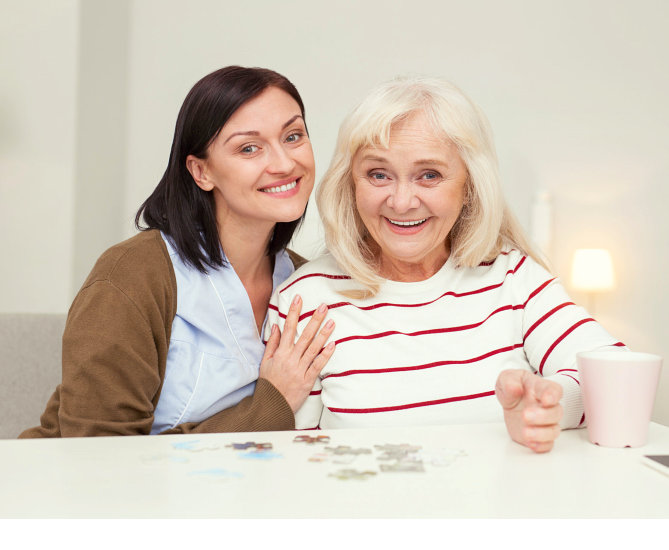 eler woman with her caregiver